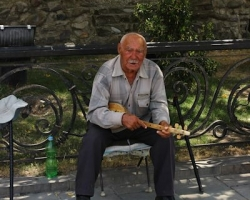 Busker outside Svetitskhoveli Cathedral